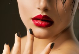 Fashion Girl Closeup. Red Lips And Black Nails. Beautiful Makeup